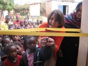 First Parish member cuts the ribbon at the new center for the Children of Ng'ob